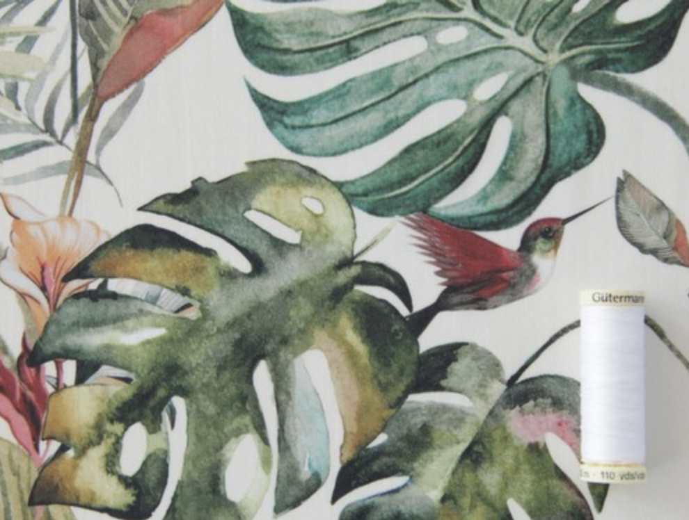 fabric with green palm leaves and hummingbirds