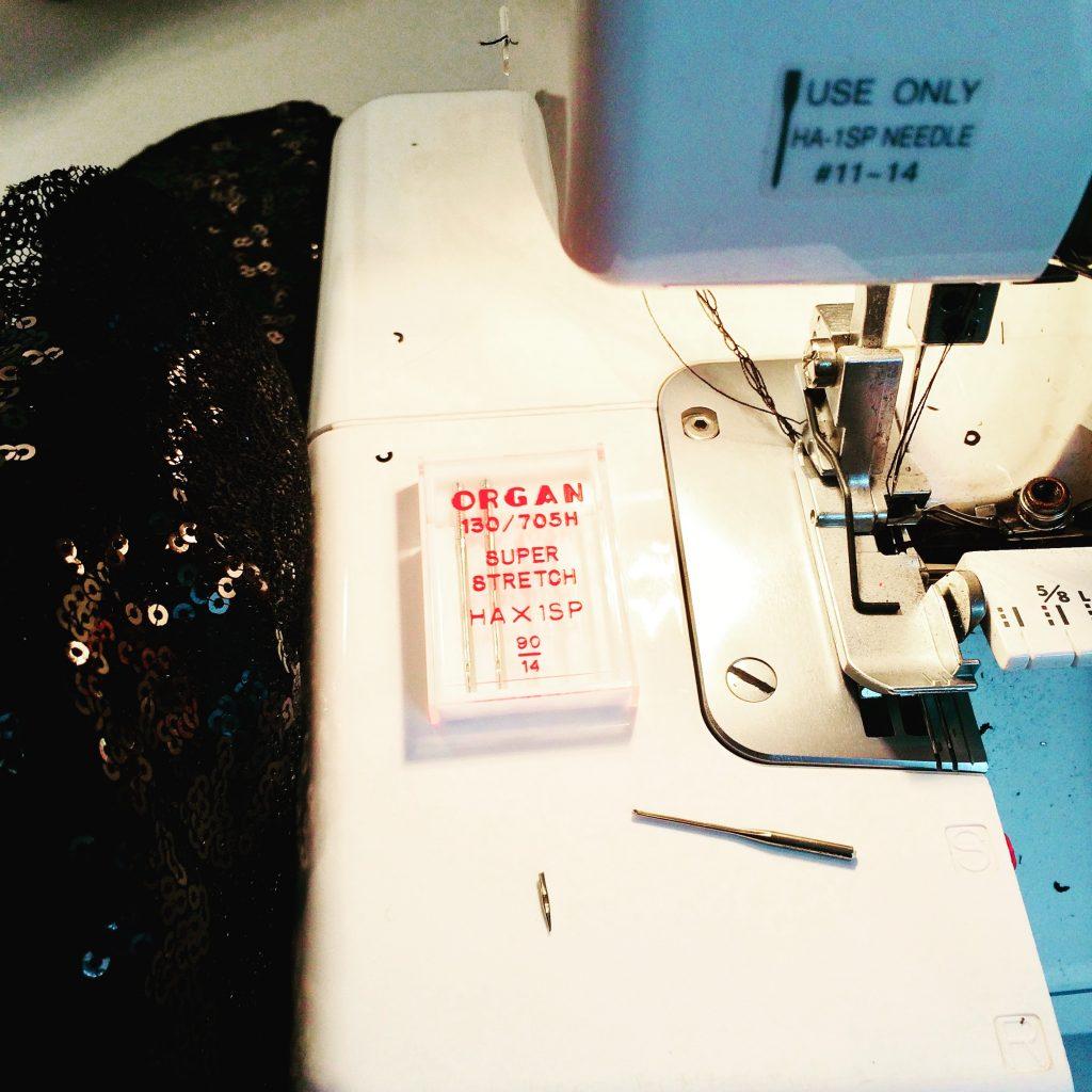 broken needle on sewing bed of overlocker