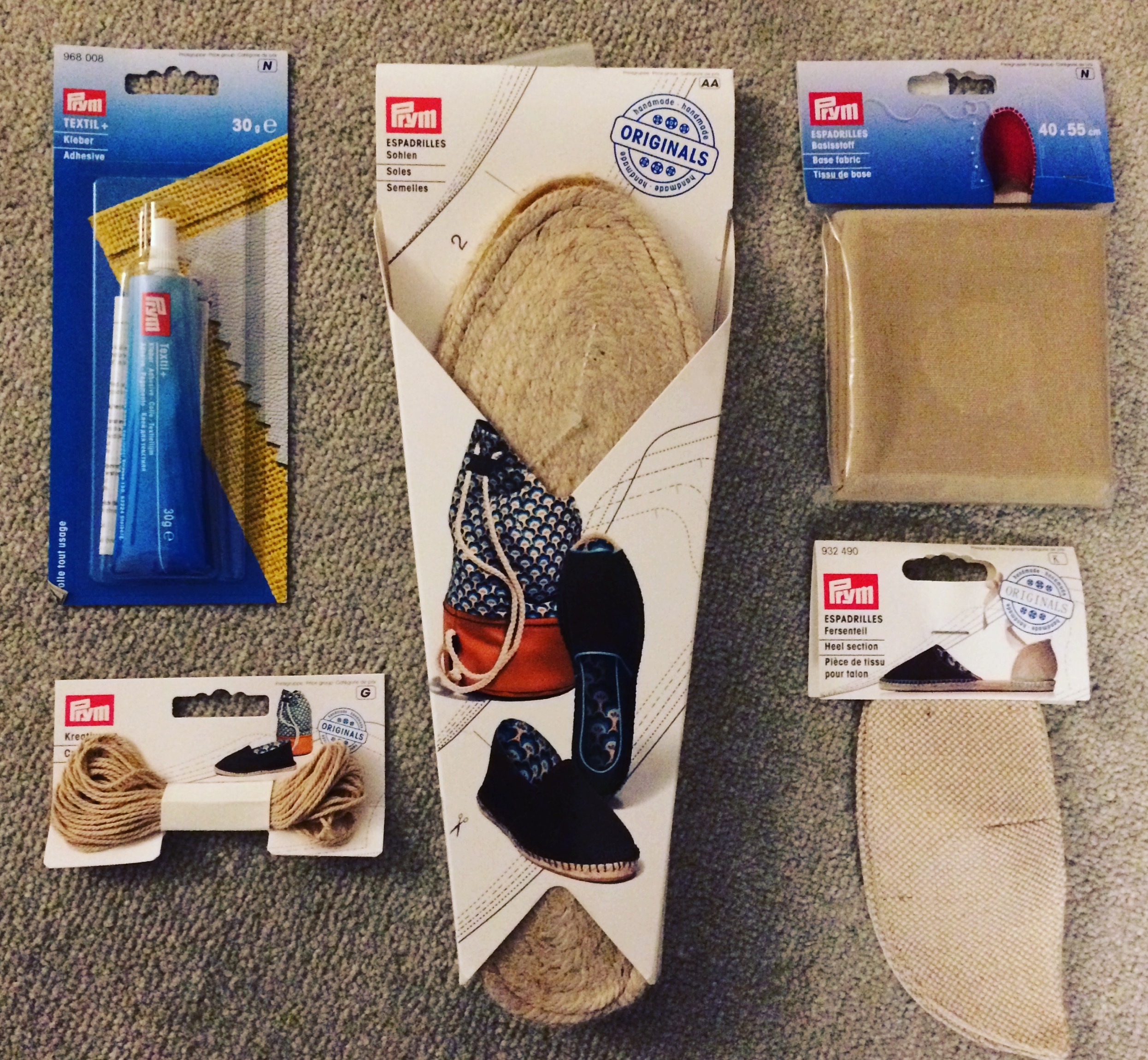 Image of fabric glue, espadrille soles, base cloth, heel sections and beige yarn for sewing together