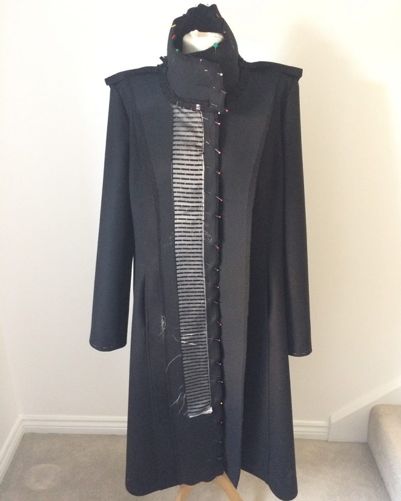 coat inside out on mannequin