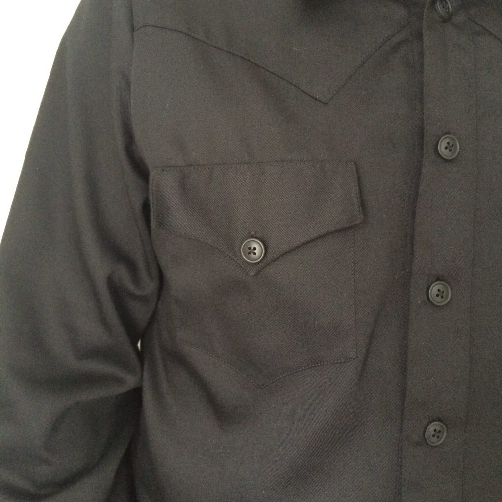 Close up of black western shirt front