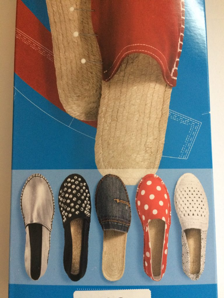 image of espadrille packaging showing basic closed toe slip on espadrille shoes